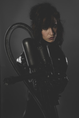 scifi, sexy woman dressed in black latex, future concept and new technologies photo