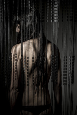 naked, nude woman back through a curtain wire