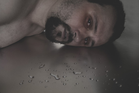anguished: Man crying in the floor