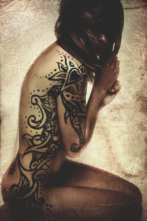 Latina with beautiful hand-painted tattoos on the skin Stock Photo