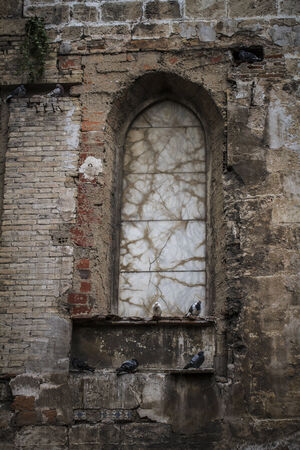 ruined house: old gothic window, Spanish city of Valencia, Mediterranean architecture
