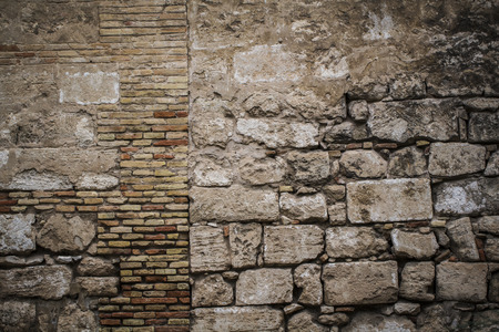 ruined house: textured stone wall, Spanish city of Valencia, Mediterranean architecture