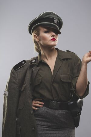 reenaction: young model, Official German woman, representation of tyranny and oppression Stock Photo