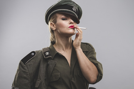 oppression: smoking, Official German woman, representation of tyranny and oppression Stock Photo