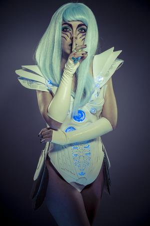 droid: Droid woman, future robot with white armor dress Stock Photo
