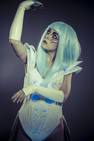 Droid woman, future robot with white armor dress photo