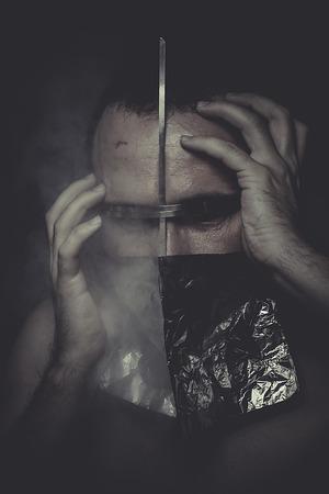 drug addiction, drug concept man with foil on the face photo