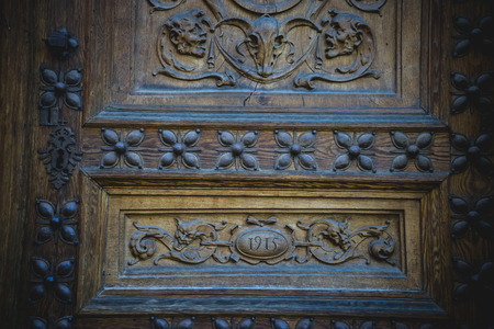 old wooden door with carvings photo