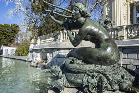 parque del buen retiro: bronze sculpture of a mermaid. Lake in Retiro park, Madrid Spain Editorial