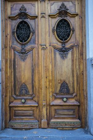 old wooden door with iron knockers photo
