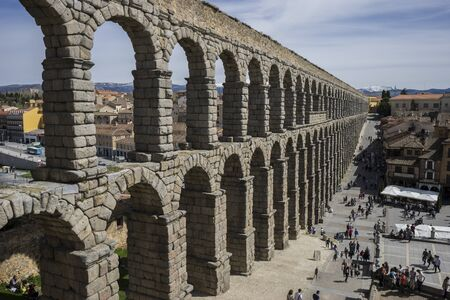 acueducto: Tourism, Roman aqueduct of segovia. architectural monument declared patrimony of humanity and international interest by UNESCO. Spain Stock Photo