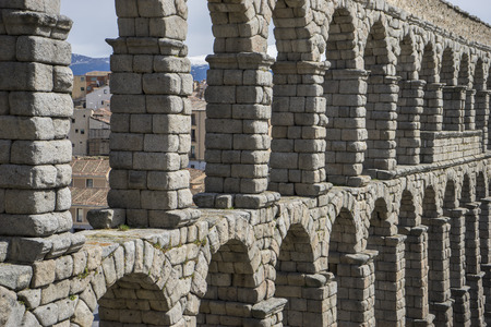 declared: Tourist, Roman aqueduct of segovia. architectural monument declared patrimony of humanity and international interest by UNESCO