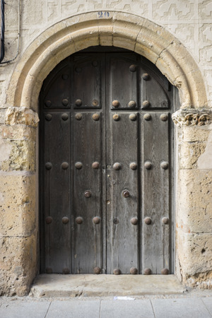 medieval door Spanish city of Segovia. Old wooden entrance. ancient architecture photo