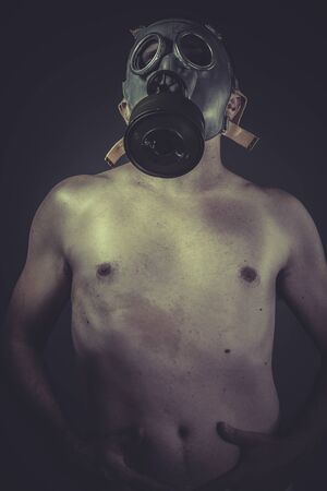Danger ebola, concept of risk of contamination, naked man with gas mask photo