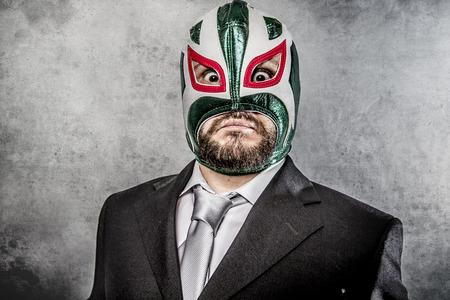 メキシコ レスラー マスクと怒っているビジネスマン 写真素材