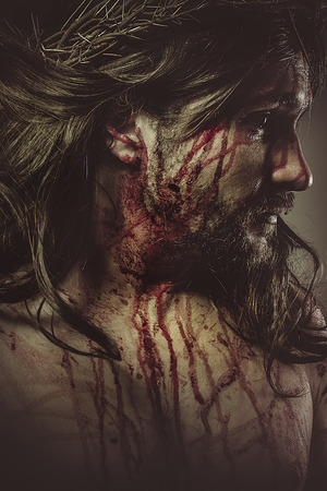 Jesus Christ with crown of thorns and blood on his face Stock Photo