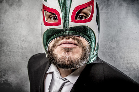 angry businessman  with Mexican wrestler mask Reklamní fotografie