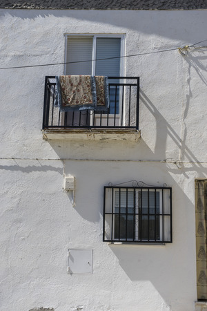 spanish houses: Balcony, houses and typical Spanish architecture, white buildings, Mediterranean style Stock Photo