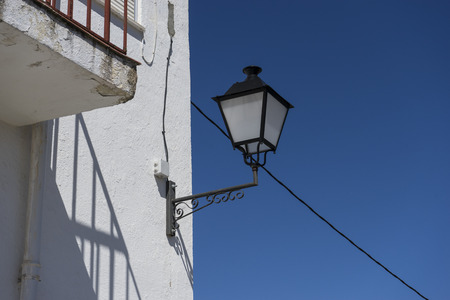 spanish architecture: Street light, houses and typical Spanish architecture, white buildings, Mediterranean style