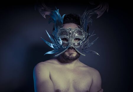 Mystery and Renaissance, adult man with mask silver and precious stones Stock Photo