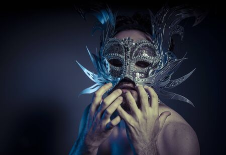 Costume, bearded man with silver mask Venetian style. Mystery and renaissance Stock Photo