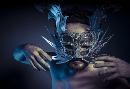 venecian: bearded man with silver mask Venetian style. Mystery and renaissance Stock Photo