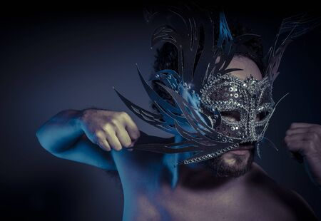 Carnival, bearded man with silver mask Venetian style. Mystery and renaissance