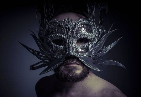 venecian: Treasure, jewels and silver. Man with mask of precious metals Stock Photo