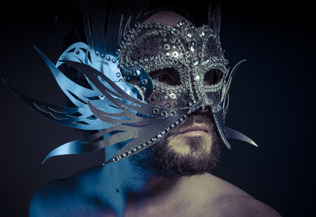 venecian: Ego, bearded man with silver mask Venetian style. Mystery and renaissance