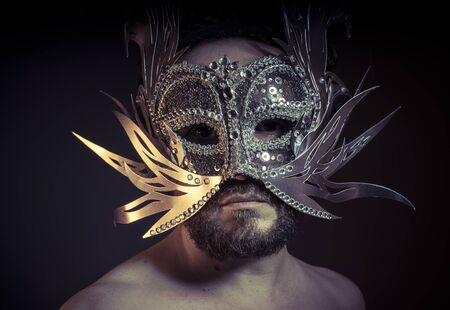 Theater, bearded man with silver mask Venetian style. Mystery and renaissance