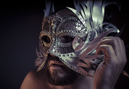 venecian: Mystery and Renaissance, adult man with mask silver and precious stones Stock Photo