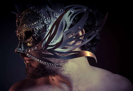 venecian: Gold, Treasure, jewels and silver. Man with mask of precious metals Stock Photo