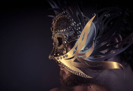 Gold, Treasure, jewels and silver. Man with mask of precious metals Stock Photo