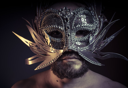 venician: Treasure, jewels and silver. Man with mask of precious metals Stock Photo