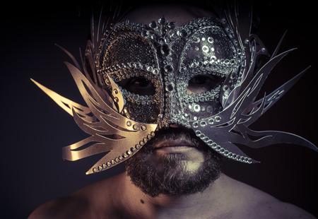venecian: Treasure, jewels and silver. Man with mask of precious metals Stock Photo