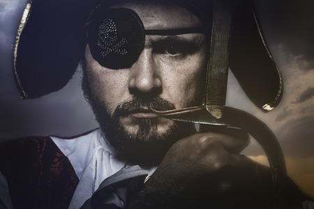 eye patch: pirate with hat and eye patch holding a sword Stock Photo