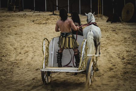 chariot: Leading, chariot race in a Roman circus, gladiators and slaves fighting