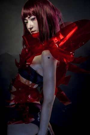 cos: Future, robot with red armor, beautiful young Japanese woman in a suit methacrylate Stock Photo