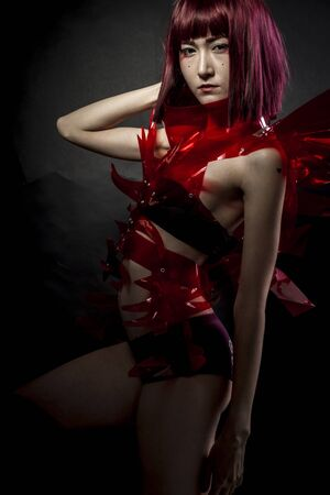 cos: geisha robot with red armor, beautiful young Japanese woman in a suit methacrylate Stock Photo