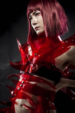 cos: robot with red armor, beautiful young Japanese woman in a suit methacrylate Stock Photo