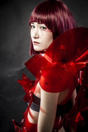 cos: Manga robot with red armor, beautiful young Japanese woman in a suit methacrylate