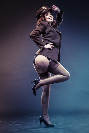 Lady, pinup girl in sexy clothes era of World War II 스톡 콘텐츠