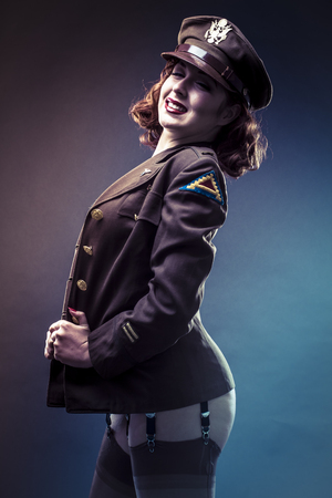 Retro, pinup girl in sexy clothes era of World War II Reklamní fotografie - 92538724