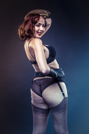 Lady, pinup girl in sexy clothes era of World War II Stock Photo
