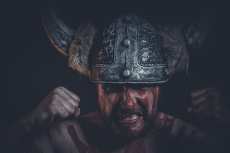 aggression: Aggression, Viking warrior with a horned helmet and war paint on his face