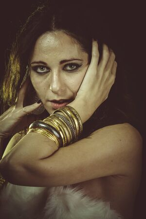 white fur: Love, brunette woman wearing white fur and gold jewelry