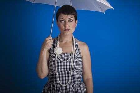 joyless: Joyless, pinup girl style of the 50s with a white umbrella