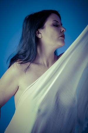 muse: Greek muse with white veil, beautiful brunette woman with long cloth