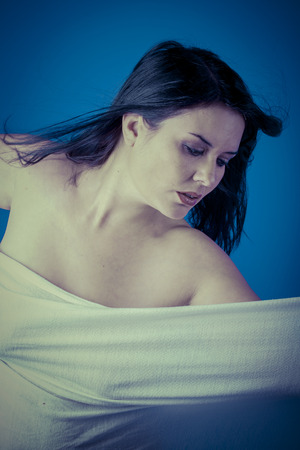 muse: Talent, Greek muse with white veil, beautiful brunette woman with long cloth Stock Photo