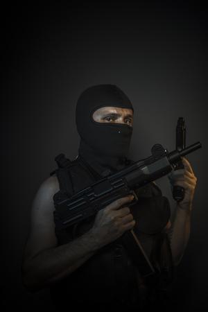bulletproof vest: Robber, Man wearing balaclavas and bulletproof vest with firearms Stock Photo